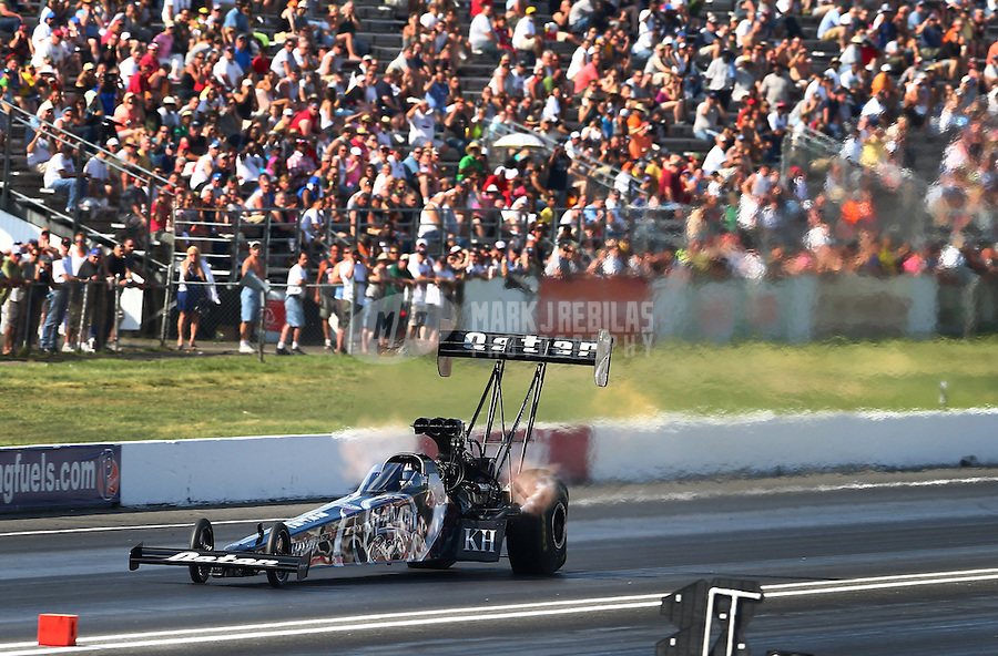 Jun. 1, 2013; Englishtown, NJ, USA: NHRA top fuel driver Shawn Langdon during qualifying for the Summer Nationals at Raceway Park. Mandatory Credit: Mark J. Rebilas-