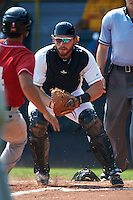 Clinton LumberKings catcher Adam Martin (27) tags Garrett Kennedy (14) out at home during a game against the Great Lakes Loons on August 16, 2015 at Ashford University Field in Clinton, Iowa.  Great Lakes defeated Clinton 3-2.  (Mike Janes/Four Seam Images)