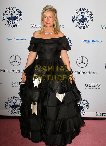 KATHY HILTON.The 32nd Annual Carousel Of Hope Ball held at The Beverly Hilton Hotel, Beverly Hills, CA, USA..October 23rd, 2010.full length black dress gown off the shoulder layers layered .CAP/ADM/KB.©Kevan Brooks/AdMedia/Capital Pictures.