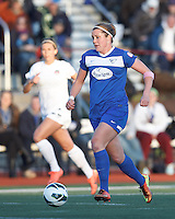 Boston Breakers forward Katie Schoepfer (12) brings the ball forward.  In a National Women's Soccer League Elite (NWSL) match, the Boston Breakers (blue) tied the Washington Spirit (white), 1-1, at Dilboy Stadium on April 14, 2012.