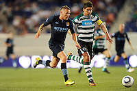 Craig Bellamy (39) of Manchester City F. C. and Daniel Carrico (3) of Sporting Clube de Portugal race to a ball. Sporting Clube de Portugal defeated Manchester City F. C. 2-0 during a Barclays New York Challenge match at Red Bull Arena in Harrison, NJ, on July 23, 2010.