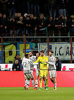 Calcio, Coppa Italia: semifinale di ritorno Inter vs Juventus. Milano, stadio San Siro, 2 marzo 2016. <br /> Juventus players, from left, Alex Sandro, Andrea Barzagli, Leonardo Bonucci, Neto and Alvaro Morata celebrate after winning a penalty shootout at the end of the Italian Cup second leg semifinal football match between Inter and Juventus at Milan's San Siro stadium, 2 March 2016.<br /> UPDATE IMAGES PRESS/Isabella Bonotto