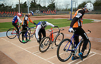 19 APR 2015 - IPSWICH, GBR - Competitors check their bikes before the of a heat at the Elite League cycle speedway fixture between Ipswich Eagles and Sheffield Stars at Whitton Sports and Community Centre in Ipswich, Suffolk, Great Britain (PHOTO COPYRIGHT © 2015 NIGEL FARROW, ALL RIGHTS RESERVED)