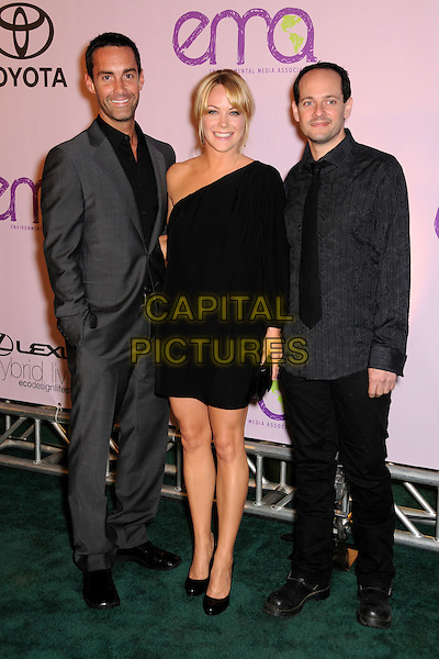 BETTER OFF TED CAST - JAY HARRINGTON, ANDREA ANDERS & JONATHAN SLAVIN .2009 Environmental Media Awards held at Paramount Studios, Los Angeles, California, USA, .25th October 2009..full length black one shoulder grey gray shirt suit tie .CAP/ADM/BP.©Byron Purvis/Admedia/Capital Pictures