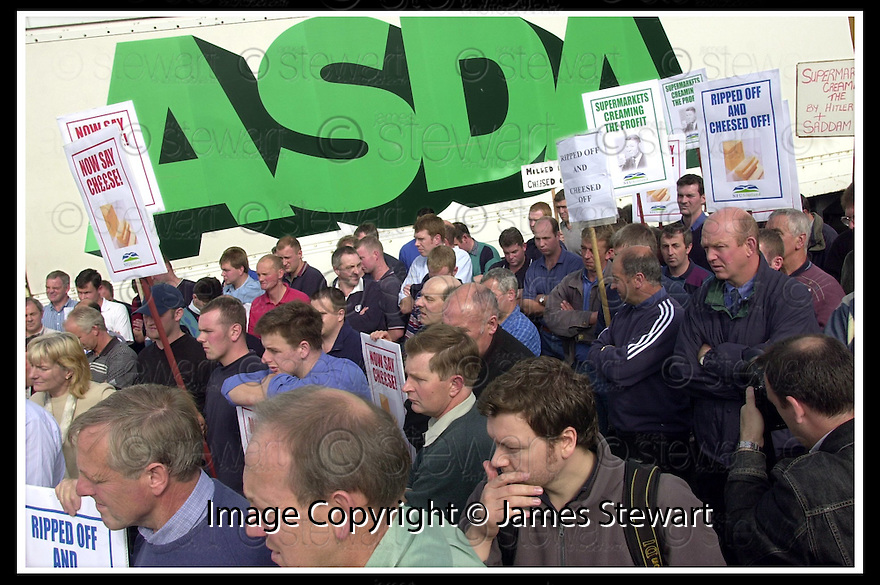 19/9/02       Copyright Pic : James Stewart                     .File Name : stewart-nufs protest 07.MEMBERS OF THE NATIONAL FARMERS UNION PROTEST OUTSIDE THE ASDA DISTRIBUTION DEPOT IN GRANGEMOUTH OVER THE PRICE PAID BY SUPERMARKET FOR DAIRY PRODUCE......James Stewart Photo Agency, 19 Carronlea Drive, Falkirk. FK2 8DN      Vat Reg No. 607 6932 25.Office : +44 (0)1324 570906     .Mobile : + 44 (0)7721 416997.Fax     :  +44 (0)1324 570906.E-mail : jim@jspa.co.uk.If you require further information then contact Jim Stewart on any of the numbers above.........