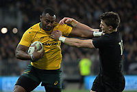 Beauden Barrett (right) tries to tackle Tevita Kuridrani during the Rugby Championship and Bledisloe Cup rugby match between the New Zealand All Blacks and Australia Wallabies at Forsyth Barr Stadium in Dunedin, New Zealand on Saturday, 26 August 2017. Photo: Dave Lintott / lintottphoto.co.nz