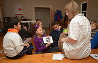 NWA Democrat-Gazette/ANDY SHUPE<br /> Instructor Heather Younger Morton (right) listens as Layla Sisemore (left), 8, gives her idea Wednesday, Jan. 3, 2018, of what an ink blot painting resembles during BLACKOUT, a youth art camp at Artist's Laboratory Theatre in Fayetteville. The eight-day pay-what-you-can camp is exploring the affect of light and dark through art, performance and science experiments and runs through Friday.