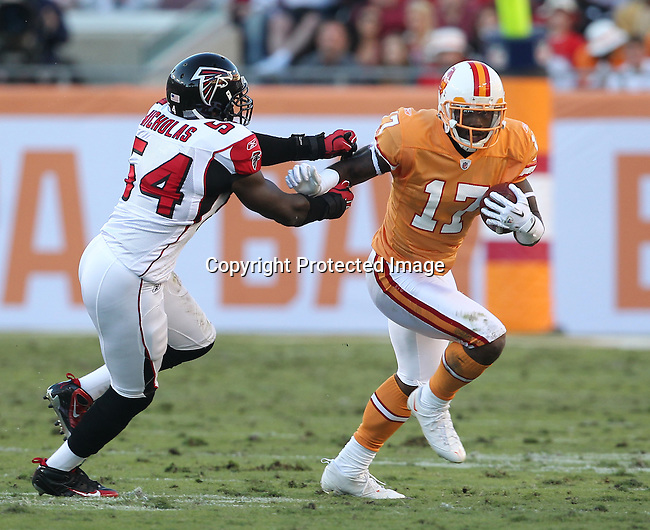 Tampa Bay Buccaneers wide receiver Arrelious Benn (17) tries to find an opening in the defense as Atlanta Falcons linebacker Stephen Nicholas (54) pursues during an NFL football game Sunday in Tampa, Fla, December 5, 2010. The Falcons defeated the Buccaneers 28-24. (AP/Margaret Bowles)