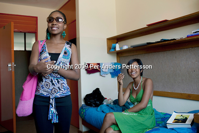 GABORONE, BOTSWANA - SEPTEMBER 22: Unidentified students socialize in the residence at the University of Botswana on September 22, 2009 in the central business district in Gaborone, Botswana. Debswana, a 50/50 partnership between the De Beers Company and the government of Botswana has brought lots of revenues to Botswana, including an impressive infrastructure such as roads and free education up to university. Many students from poor families have the opportunity to got university if their grades are good. (Photo by Per-Anders Pettersson)...