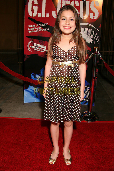 "TELANA LYNUM.""G.I. Jesus"" Los Angeles Premiere at the Egyptian Theatre, Hollywood, California, USA..January 23rd, 2007.full length dress brown gold belt polka dot.CAP/ADM/BP.©Byron Purvis/AdMedia/Capital Pictures"