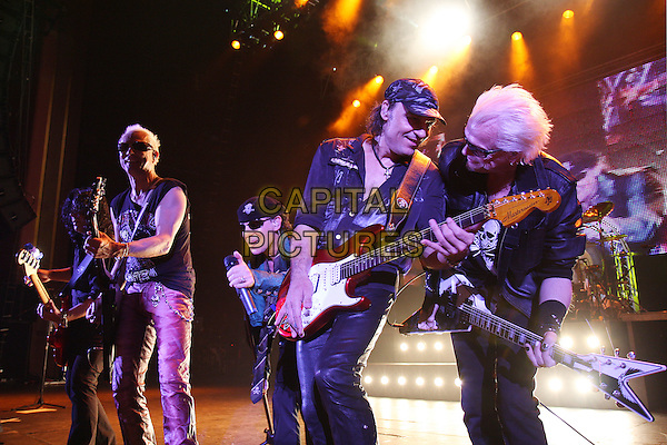THE SCORPIONS.Live at the Hammersmith Apollo, London, England..October 18th, 2008.stage concert gig performance music half 3/4 length guitar sunglasses shades black top profile hat trousers singing .CAP/MAR.©Martin Harris/Capital Pictures.