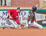 10 March 2015: Washington Nationals infielder Danny Espinosa is unable to tag a sliding Dee Gordon during Spring Training action against the Miami Marlins at Roger Dean Stadium in Jupiter, Florida. The Marlins edged out the Nationals 2-1 on a walk-off solo home run in the 9th inning of Grapefruit League play. Mandatory Credit: Ed Wolfstein Photo *** RAW (NEF) Image File Available ***