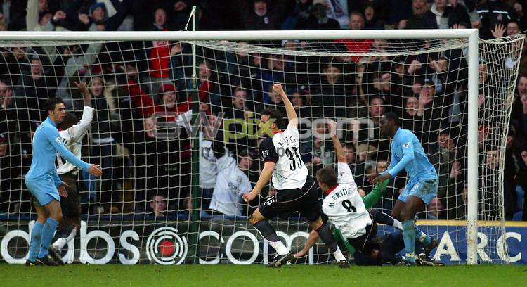 Pix: Rob Matthews/SWpix.com. Soccer. Barclaycard Premiership. Season 2003/2004. Fulham v Tottenham 31/1/2004...COPYWRIGHT PICTURE>>SIMON WILKINSON>>01943 608782>>..Ian Pierce and Brain McBride celebrate after the two new Fulham players combined to score Fulham's second goal..