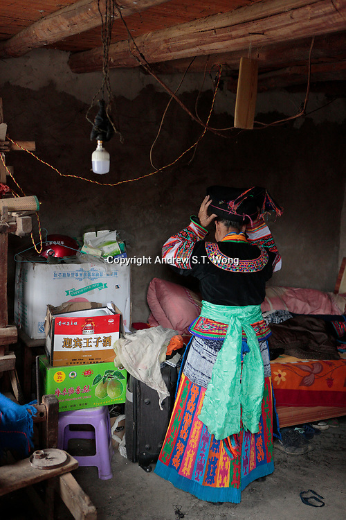A Bouyei woman puts on her traditional costumes at Guanling Bouyei and Miao Autonomous County in Guizhou Province, 2018.