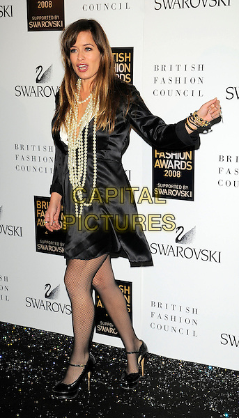 JADE JAGGER.Inside arrivals at the British Fashion Awards 2008 held at The Lawrence Hall in London, England. UK, .November 25th 2008.full length pearl necklace pearls black dress fishnet tights peep toe shoes ankle strap YSL tribute heels platforms silk satin hand mouth open.CAP/CAN.©Can Nguyen/Capital Pictures.