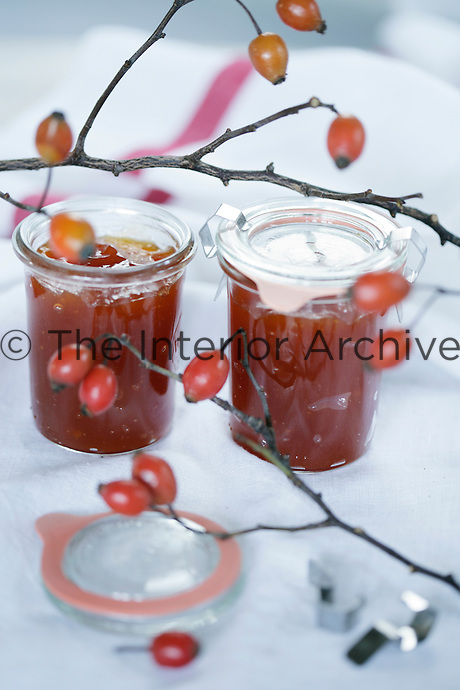 Detail of two jars of homemade rosehip jam
