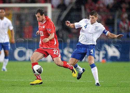 07.09.2010 European Championship Qualifier Switzerland v England. Picture shows Xavier Margairaz left Switzerland against Steven Gerrard right England.