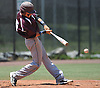 North Shore shortstop No. 5 Nick Luchese drives in a run with a single in the top of the fourth inning in Game 1 of the Nassau County varsity baseball Class A final against Division Avenue at Farmingdale State College on Saturday, May 30, 2015. Division won the opener of the best-of-three series by a score of 14-3.<br /> <br /> James Escher