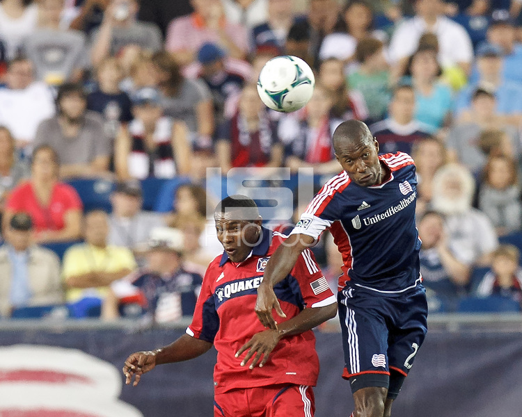 Chicago Fire midfielder Juan Luis Anangono (33) and New England Revolution defender Jose Goncalves (23) battle for head ball. In a Major League Soccer (MLS) match, the New England Revolution (blue) defeated Chicago Fire (red), 2-0, at Gillette Stadium on August 17, 2013.