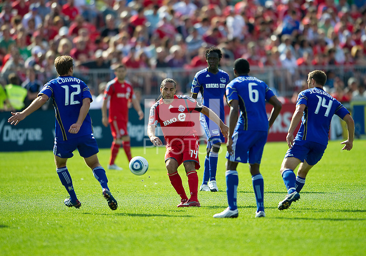 05 June 2010: Toronto FC forward Dwayne De Rosario #14 appears to be surrounded by Kansas City Wizards players during a game between the Kansas City Wizards and Toronto FC at BMO Field in Toronto..The game ended in a 0-0 draw.