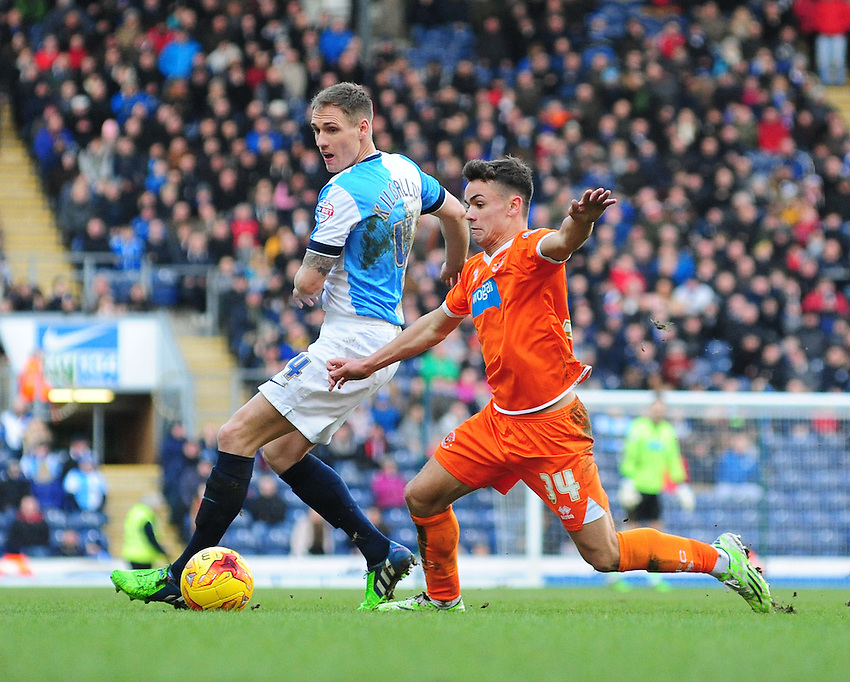 Blackpool's Dom Telford vies for possession with Blackburn Rovers' Matthew Kilgallon<br /> <br /> Photographer Chris Vaughan/CameraSport<br /> <br /> Football - The Football League Sky Bet Championship - Blackburn Rovers v Blackpool - Saturday 21st February 2015 - Ewood Park - Blackburn<br /> <br /> &copy; CameraSport - 43 Linden Ave. Countesthorpe. Leicester. England. LE8 5PG - Tel: +44 (0) 116 277 4147 - admin@camerasport.com - www.camerasport.com