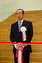 """September 17, 2011 : Yokohama, Japan - Koki Ando, president of Nisshin Foods Inc., cuts the tape at the grand opening ceremony of the Nissin Cup Noodles Museum. Visitors can learn about the history of the Cup Noodles product and partake in a session to make their own homemade instant ramen noodles at the museum's """"Chikin Noodle Factory"""". The museum's art director, Kashiwa Sato, is also in charge of graphic design for the massive Japanese clothes retailer Uniqlo. (Photo by Yumeto Yamazaki/AFLO)"""
