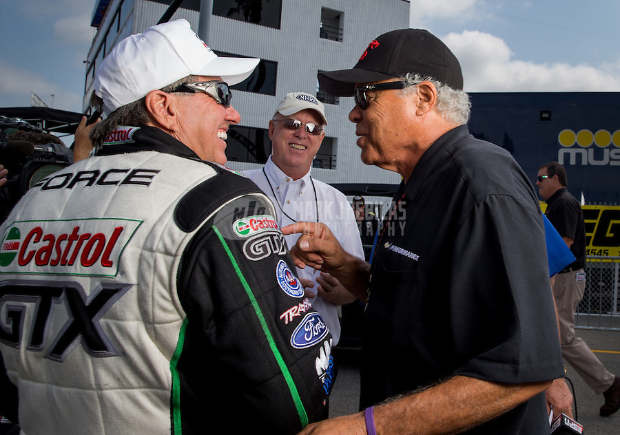 Sept. 1, 2013; Clermont, IN, USA: NHRA funny car driver John Force (left) with Don Prudhomme during qualifying for the US Nationals at Lucas Oil Raceway. Mandatory Credit: Mark J. Rebilas-