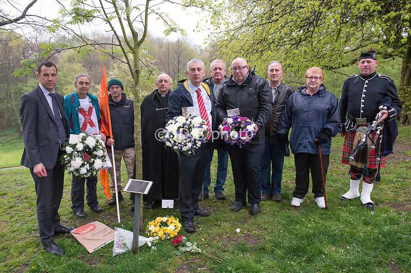 L-R Alistair Bradley (Leader of the Council), <br /> Hilda Palmer, Heath Watkinson (hosptial worker with flag), Reverend Tim Wilby, Lindsay Hoyle MP, John Waddington, Steve Turner (holding wreath), Charlie Clutterbuck, Sheila Draper ( husband was killed at work) and Piper - Bob Wilson