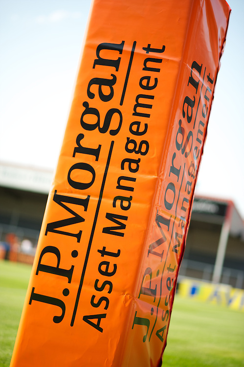 20130801 Copyright onEdition 2013 ©<br />Free for editorial use image, please credit: onEdition.<br /><br />JP Morgan branding on a post wrap during the J.P. Morgan Asset Management Premiership Rugby 7s Series.<br /><br />The J.P. Morgan Asset Management Premiership Rugby 7s Series kicks off for the fourth season on Thursday 1st August with Pool A at Kingsholm, Gloucester with Pool B being played at Franklin's Gardens, Northampton on Friday 2nd August, Pool C at Allianz Park, Saracens home ground, on Saturday 3rd August and the Final being played at The Recreation Ground, Bath on Friday 9th August. The innovative tournament, which involves all 12 Premiership Rugby clubs, offers a fantastic platform for some of the country's finest young athletes to be exposed to the excitement, pressures and skills required to compete at an elite level.<br /><br />The 12 Premiership Rugby clubs are divided into three groups for the tournament, with the winner and runner up of each regional event going through to the Final. There are six games each evening, with each match consisting of two 7 minute halves with a 2 minute break at half time.<br /><br />For additional images please go to: http://www.w-w-i.com/jp_morgan_premiership_sevens/<br /><br />For press contacts contact: Beth Begg at brandRapport on D: +44 (0)20 7932 5813 M: +44 (0)7900 88231 E: BBegg@brand-rapport.com<br /><br />If you require a higher resolution image or you have any other onEdition photographic enquiries, please contact onEdition on 0845 900 2 900 or email info@onEdition.com<br />This image is copyright the onEdition 2013©.<br /><br />This image has been supplied by onEdition and must be credited onEdition. The author is asserting his full Moral rights in relation to the publication of this image. Rights for onward transmission of any image or file is not granted or implied. Changing or deleting Copyright information is illegal as specified in the Copyright, Design and Patents Act 1988. If you are in any way 