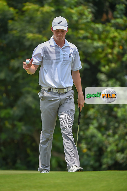 Daniel HILLIER (NZL) after sinking his putt on 4 during Rd 2 of the Asia-Pacific Amateur Championship, Sentosa Golf Club, Singapore. 10/5/2018.<br /> Picture: Golffile | Ken Murray<br /> <br /> <br /> All photo usage must carry mandatory copyright credit (© Golffile | Ken Murray)