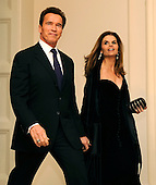 Washington, DC - February 22, 2009 -- California Republican Governor Arnold Schwarzenegger and wife Maria arrive for a black-tie dinner at the White House, Sunday, February 22, 2009.  The National Governors Association has been holding their 2009 Winter Meeting this weekend, where the nation's governors have been discussing Obama's stimulus program, as well as health care, infrastructure and education.    .Credit: Mike Theiler - Pool via CNP