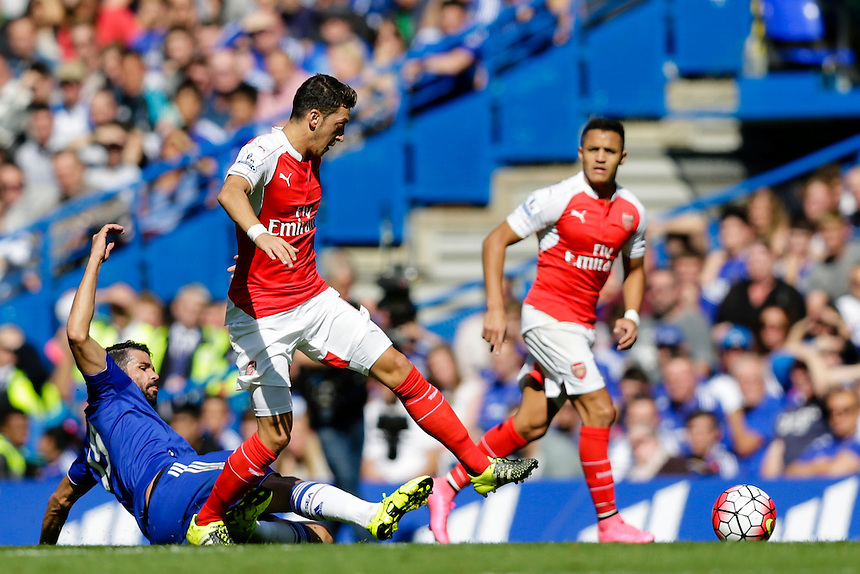 Arsenal's Mesut Ozil is tackled by Chelsea's Diego Costa<br /> <br /> Photographer Craig Mercer/CameraSport<br /> <br /> Football - Barclays Premiership - Chelsea v Arsenal - Saturday 19th September 2015 - Stamford Bridge - London<br /> <br /> &copy; CameraSport - 43 Linden Ave. Countesthorpe. Leicester. England. LE8 5PG - Tel: +44 (0) 116 277 4147 - admin@camerasport.com - www.camerasport.com