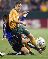 Ned Grabavoy of the LA Galaxy collides with Terry Cooke of the Colorado Rapids at the Home Depot Center in Carson, CA on September 10, 2005.  (Photo by Brooks Parkenridge/ISI)