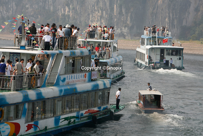 Tourist boats line up on the Lijiang River between Guilin and Yangshuo in Guangxi Province, China..04 Oct 2006