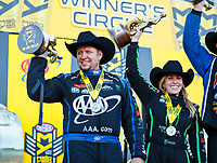 Oct 15, 2017; Ennis, TX, USA; NHRA funny car driver Robert Hight (left) and top fuel driver Brittany Force celebrate after winning the Fall Nationals at the Texas Motorplex. Mandatory Credit: Mark J. Rebilas-USA TODAY Sports