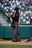 Umpire Blake Carnahan calls a strike during an International League game between the Pawtucket Red Sox and Buffalo Bisons on August 25, 2019 at Sahlen Field in Buffalo, New York.  Buffalo defeated Pawtucket 5-4 in 11 innings.  (Mike Janes/Four Seam Images)