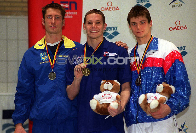 Pix: Ben Duffy/SWpix.com....International Swimming-European Short Course Championships, Antwerp, Belgium.....16/12/2001..COPYWRIGHT PICTURE>>SIMON WILKINSON>>01943 436649>>..James Hickman on the podium with his Gold medal after winning the 200m Butterfly final at the European Short Course Championships, Antwerp, Belgium.