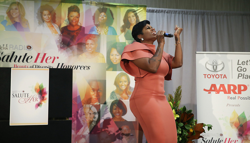 Soul Solidarity Award Honoree Fantasia Barrino-Tyalor is seen signing while accepting her award at the Salute Her Awards sponsored by Toyota and AARP in Charlotte.