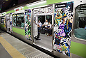 "September 6, 2013, Tokyo, Japan - The ""JoJo train"" promotes the new PS3's fighting game ""JoJo's Bizarre Adventure: All Stars Battle"" released on August 29. The train has been decorated inside and out with characters of the game. The train is running every day from 7:00 to 22:00 at Yamanote line one of the most transit line in Tokyo, form August 26 to September 9. Play Station (Japan) also has released a special website to locate in real-time the position of the train on the loop line.  (Photo by Rodrigo Reyes Marin/AFLO)"