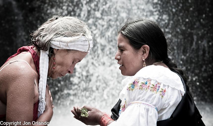 Members of The Pakarinka Sisari Ancestral Wisdom Center near Otavalo, Ecuador,  take part in a ritual honoring water.