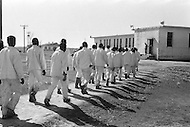 February 1968, Arkansas, USA --- Prisoners walking in the Cummins Unit or farm area of the Arkansas State Penitentiary in 1968. The scandal of this Arkansas historical penitentiary inspired the making of the 1980 movie Brubaker.