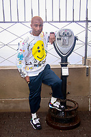 NEW YORK, NY - SEPTEMBER 10: Pharrell Williams  lights the Empire State Building in support of Young Audiences Arts for Learning and The Yellow Ball, in partnership with American Express  on September 10, 2018 in New York City. <br /> CAP/MPI99<br /> &copy;MPI99/Capital Pictures