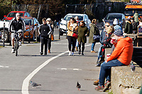 Pictured: People enjoy the sunshine by the seaside in Mumbles near Swansea, Wales, UK. Sunday 22 March 2020<br /> Re: Covid-19 Coronavirus pandemic, UK.