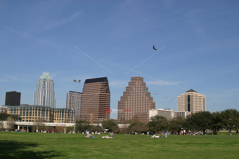 A favorite Austin pastime is flying a kite on Auditorium Shores on Town Lake Austin