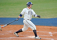 Florida International University catcher Iosmet Leon (13) plays against the University of North Florida. FIU won the game 6-4 on March 13, 2012 at Miami, Florida.
