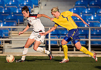 USWNT forward (15) Megan Rapinoe moves to the top of the box with Swedish midfielder (20) Lisa Dahlqvist close behind during the Algarve Cup final at the Estadio Algarve in Faro, Portual.  The USWNT lost to Sweden on penalty kicks after it was tied in regulation at 1-1.