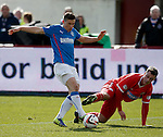 Fraser AIrd charges in on goal