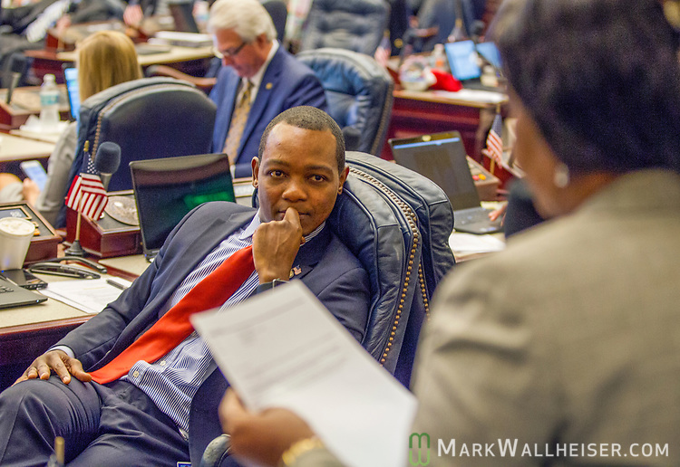 Rep. Al Jacquet, left, D-Lantana, listens to Rep. Barbara Watson, D-Miami Gardens, during Florida House of Representatives floor debate at the Florida Capitol in Tallahassee, Florida.