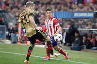 Atletico de Madrid´s Cristian Rodriguez (R) and Milan´s Ignazio Abate during 16th Champions League soccer match at Vicente Calderon stadium in Madrid, Spain. March 11, 2014. (ALTERPHOTOS/Victor Blanco)