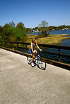 Florida: biking, Bike Withlacoochee Trail, Citrus Co, model released.  Photo: flcitr102.Photo copyright Lee Foster, 510/549-2202, lee@fostertravel.com, www.fostertravel.com